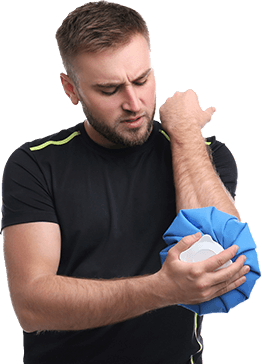 Man holding elbow